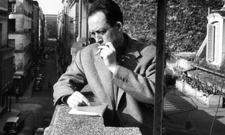 Albert Camus smoking on a balcony